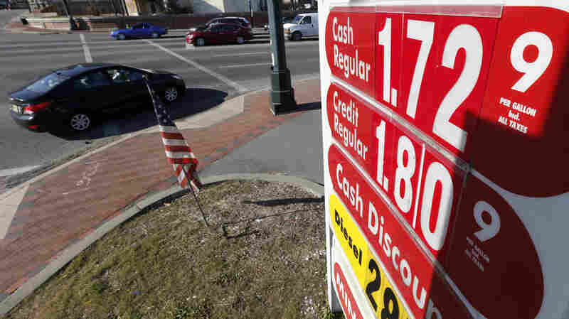 Traffic moves along Route 21 in downtown Newark, N.J., where a gas station lists the price for regular unleaded gasoline at $1.72.
