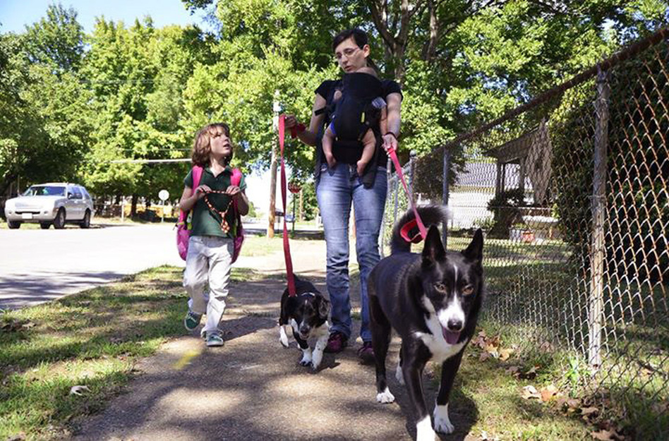 Juniper Russo walks her dogs with her daughter Vivian (left). (Courtesy of Juniper Russo)