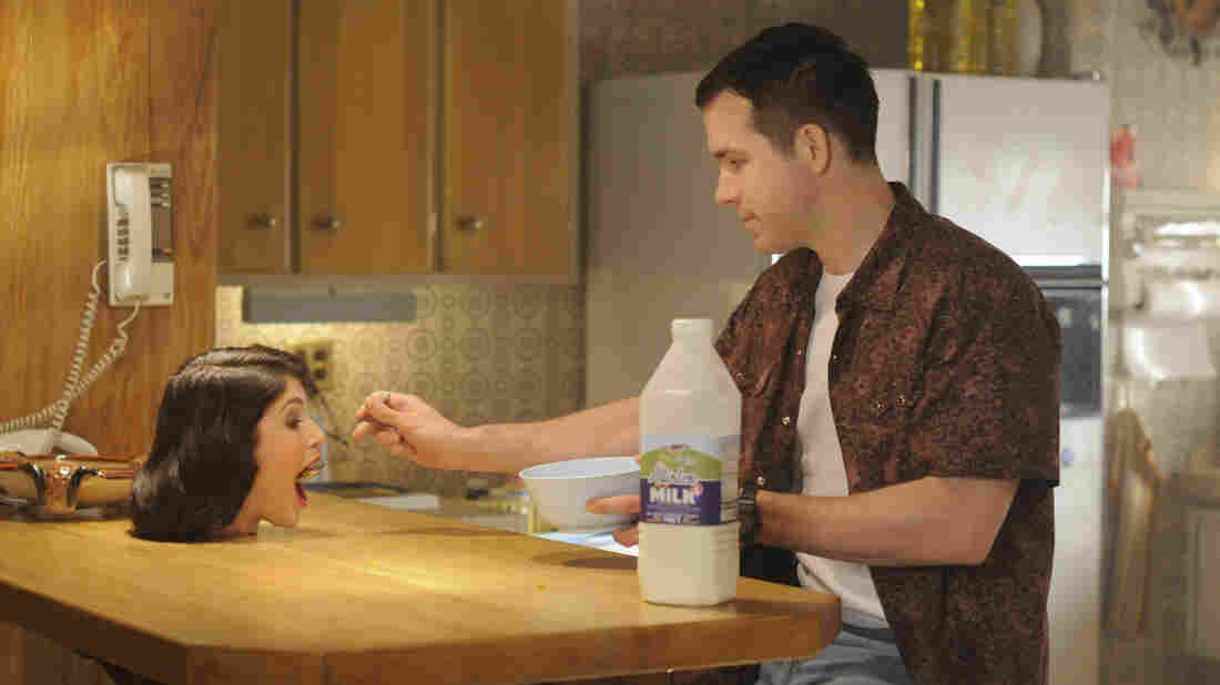 Fiona (Gemma Arterton) and Jerry (Ryan Reynolds) in The Voices.