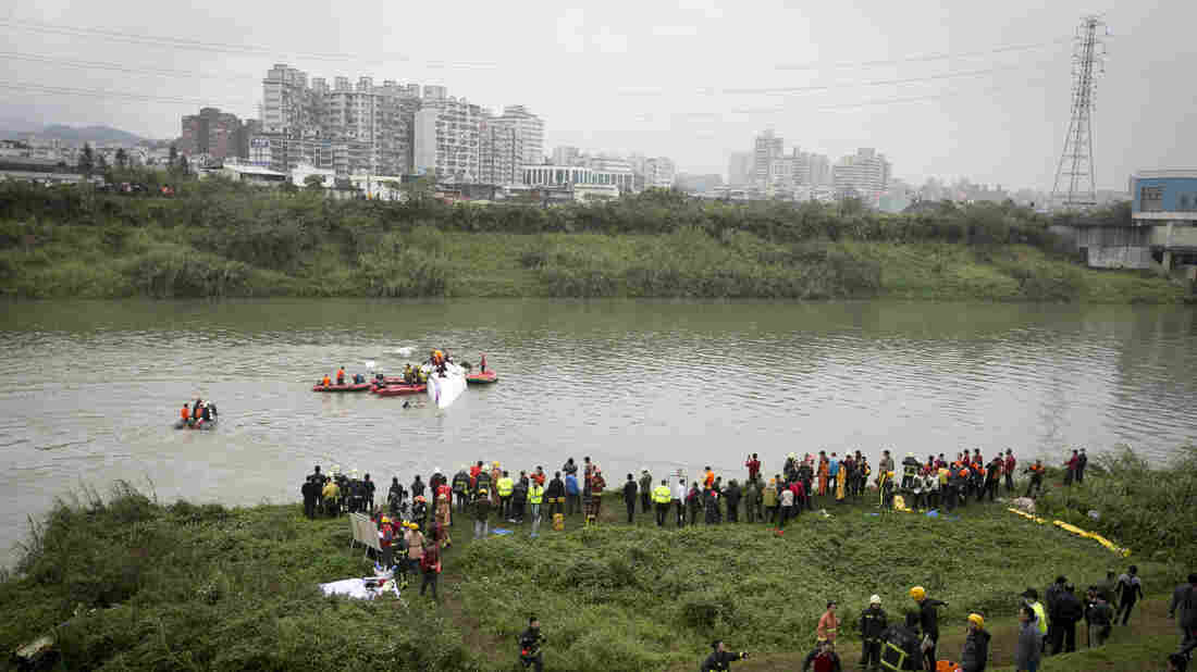 Rescue teams work to free people Wednesday from a TransAsia Airways ATR 72-600 turboprop airplane that crashed into the Keelung River shortly after takeoff from Taipei Songshan Airport in Taiwan.