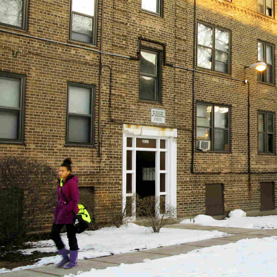 A resident of Lathrop Homes leaves one of the few occupied buildings in the development. The city wants to redevelop the public housing as mixed use, and offered vouchers to encourage residents to relocate.