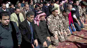 Mourners pray during a ceremony for Jordanian pilot Muath al-Kaseasbeh, who was killed by the Islamic State after he was captured in December. At Wednesday's service, which took place in the city of Karak, mourners called for the destruction of ISIS.