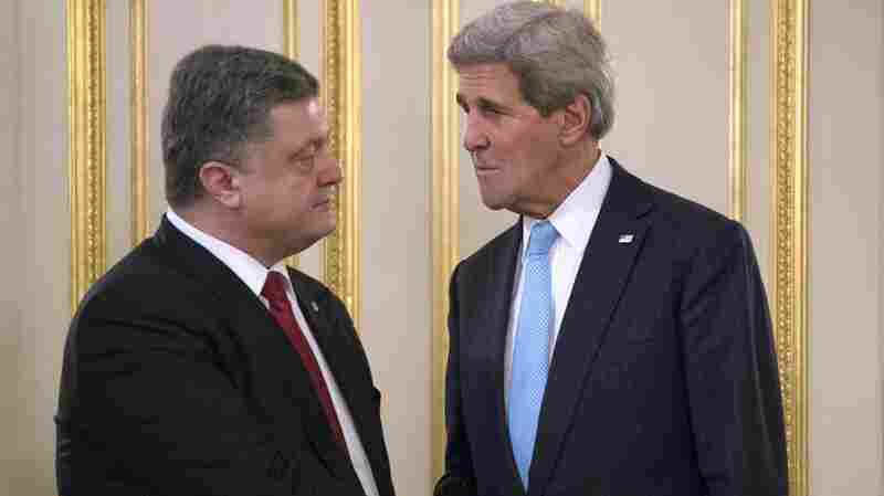 Secretary of State John Kerry shakes hands with Ukrainian President Petro Poroshenko in Kiev Thursday. The U.S. and its NATO allies are discussing how to help Ukraine maintain its borders against a separatist movement.