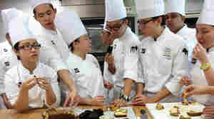 Students sample the results of their labors in Yvonne Ruperti's pastry class at the Culinary Institute of America's Singapore branch.