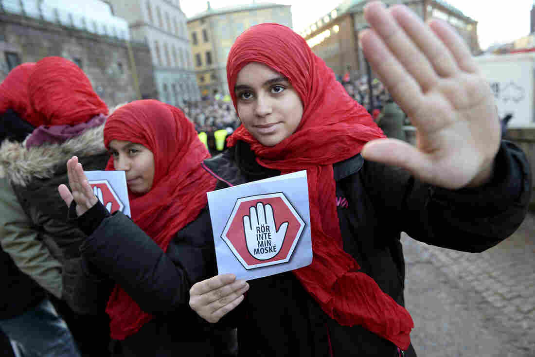 """Two young girls carry leaflets reading """"Don't touch my mosque"""" as they participate in a demonstration at the Parliament House in Stockholm last month."""