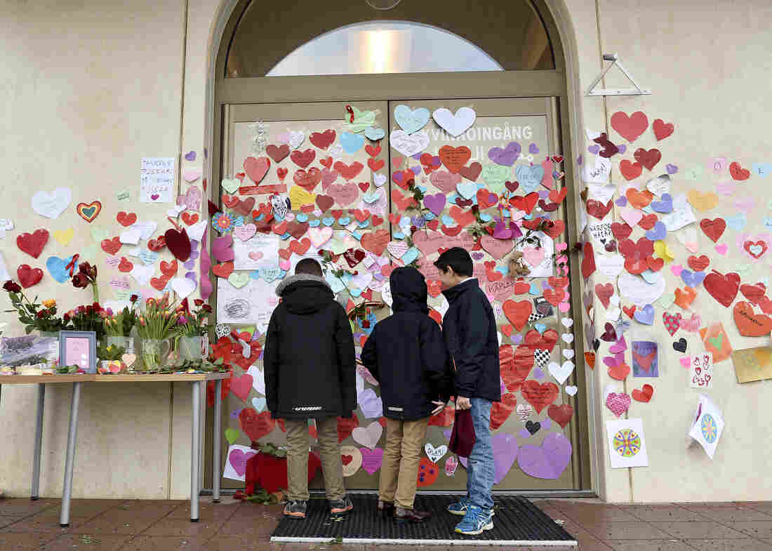 Boys read messages posted on the entrance of a mosque in Uppsala by neighbors pledging their support last month.
