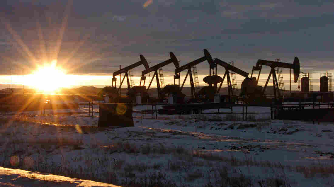 Oil pumpjacks are seen in McKenzie County in western North Dakota. Cuts in production and energy company payrolls will cost the U.S. economy up to $150 billion, economist David Kotok of Cumberland Advisors projects.
