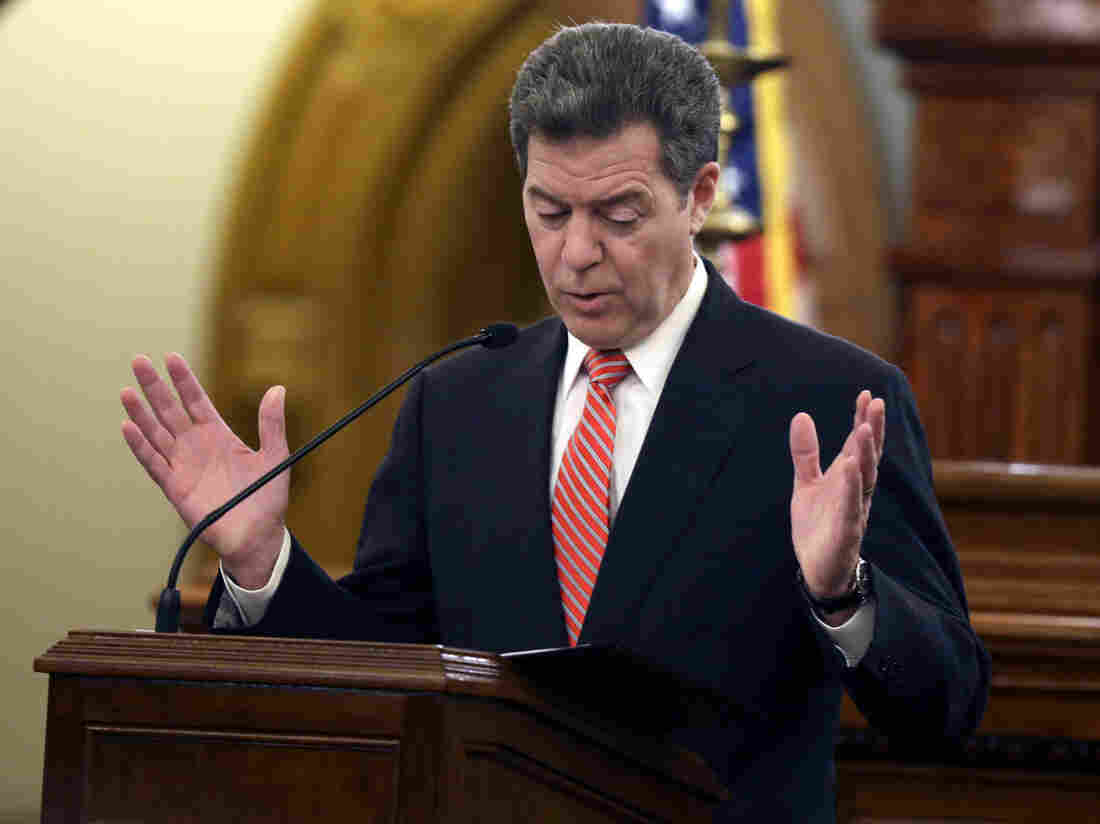 Gov. Sam Brownback delivers his State of the State address at the Kansas statehouse in Topeka last month. Brownback has announced cuts in education to plug the state's budget woes.