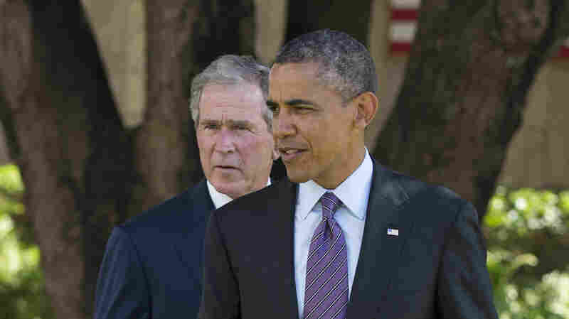 President Obama and former President George W. Bush in Dar Es Salaam, Tanzania, in 2013.