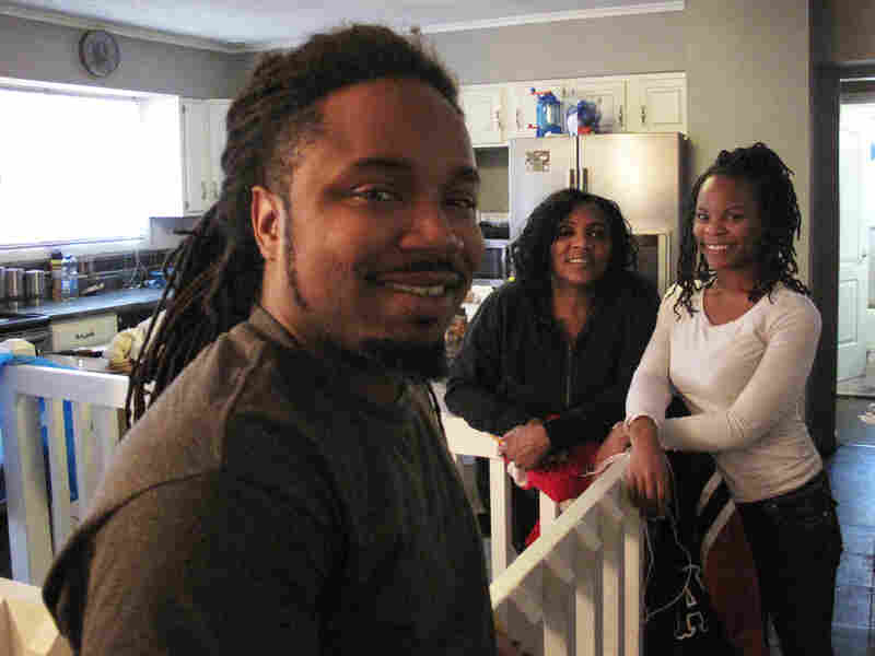 Tonya DeBerry (center) and her children, Herbert Nelson and Allison Nelson, have all been held in Ferguson and Jennings jails for unpaid traffic tickets.