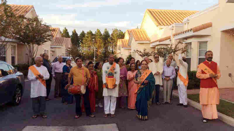 Residents of ShantiNiketan, a retirement community near Orlando, Fla., walk in a Hindu religious procession.