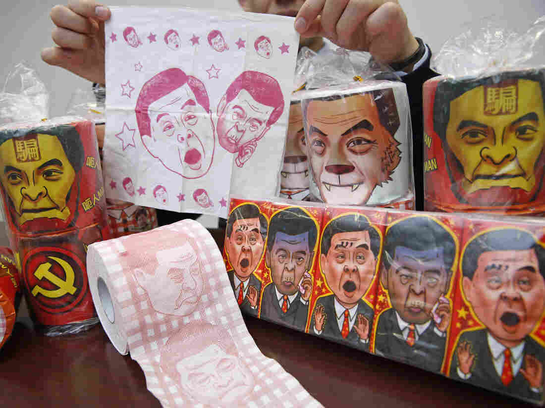 Rolls of toilet paper and packages of tissue paper printed with images of pro-Beijing Hong Kong Chief Executive Leung Chun-ying are shown Democratic Party Vice Chairman Lo Kin-hei in Hong Kong on Saturday.