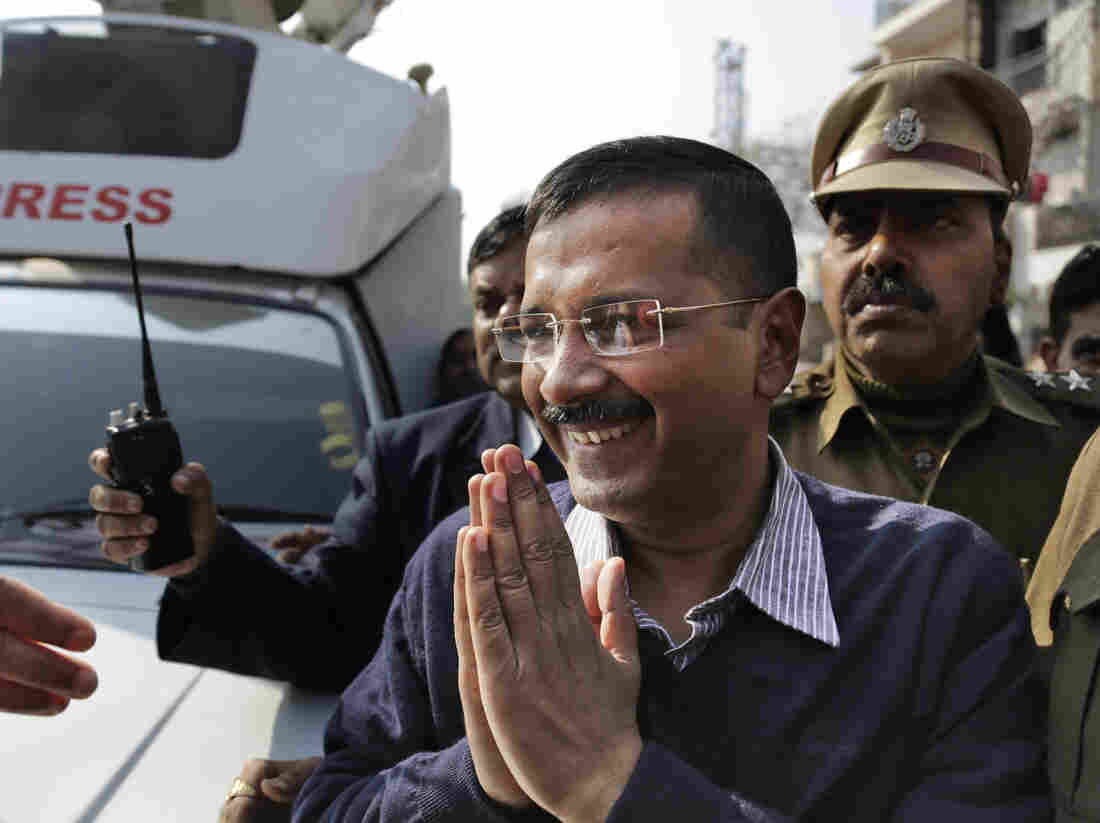 Aam Aadmi Party, or Common Man's Party, leader Arvind Kejriwal gestures as he comes out of a polling station after casting his vote in New Delhi, India, on Saturday.