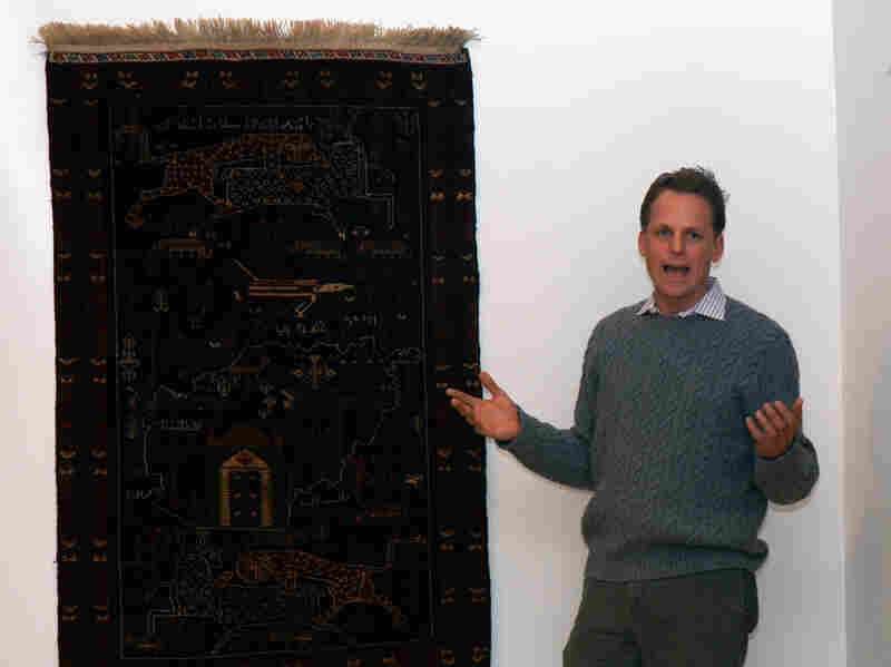 Kevin Sudeith, shown at a 2005 exhibit in Davidson, N.C., collects, shows and sells Afghan war rugs.
