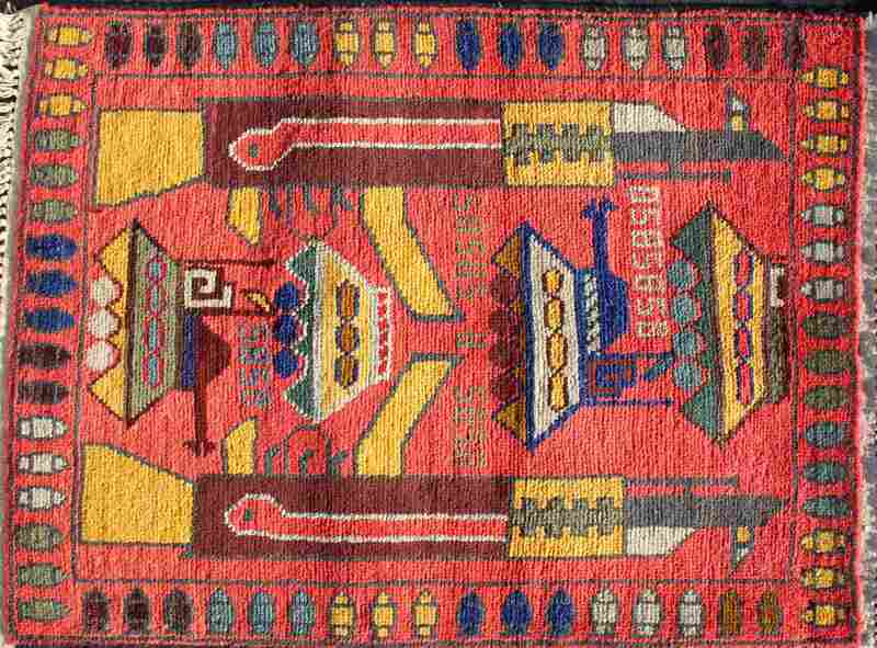 Another war rug features both AK-47s and tanks.