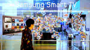 A man walks past a Samsung smart TV advertisement at a showroom in Seoul in 2011.