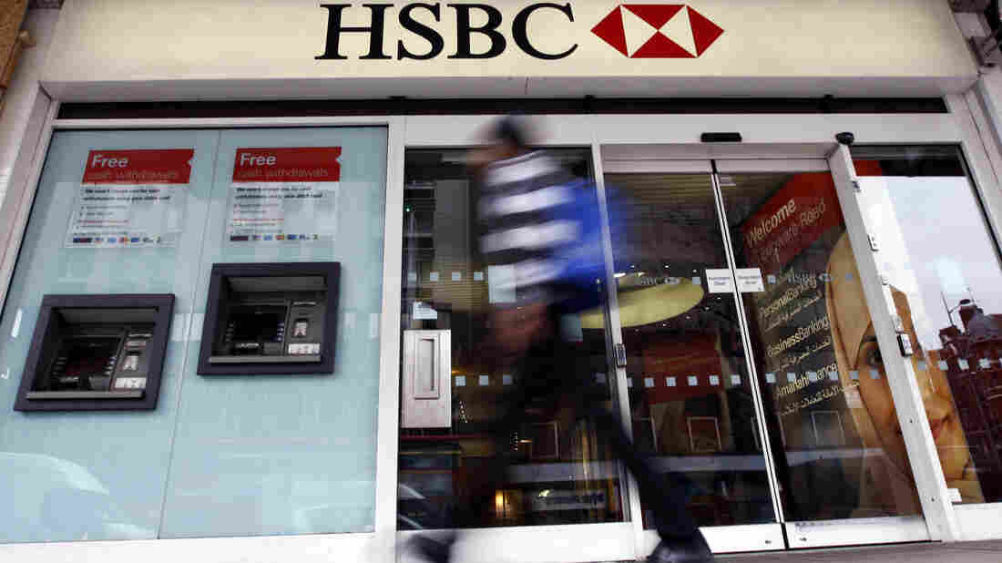 A pedestrian passes a branch of HSBC bank in London.