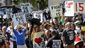 Fast-food workers in Los Angeles march in August 2013 to raise the minimum wage to $15 an hour. Similar protests around the country have been organized by labor unions.