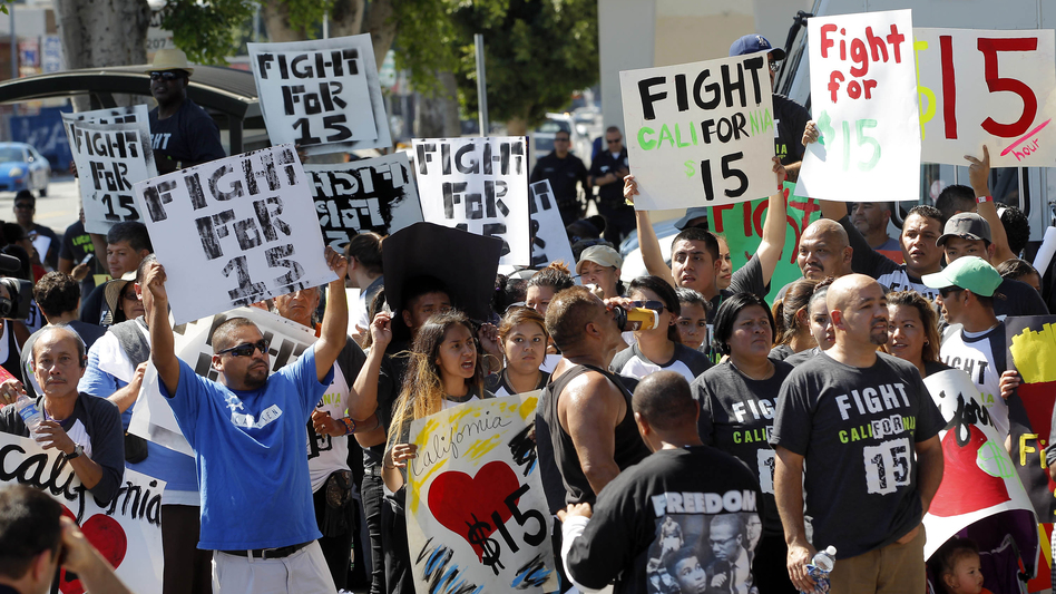 Fast-food workers in Los Angeles march in August 2013 to raise the minimum wage to $15 an hour. Similar protests around the country have been organized by labor unions. (Nick Ut/AP)