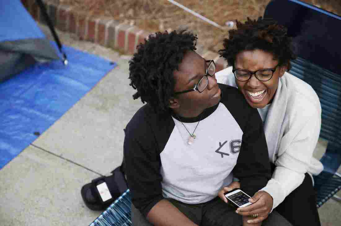 Shante Wolfe (left) and Tori Sisson camped outside the Montgomery County Courthouse on Sunday.