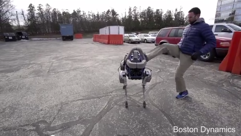 A Boston Dynamics robot called Spot is kicked by a human. (Boston Dynamics via YouTube)