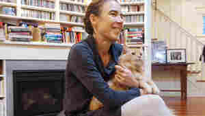 """Back in Seattle after six weeks of Ebola duty in West Africa, Karin Huster was told by the health department that she might want to send away her two cats during her quarantine — """"just in case."""" The cats didn't go anywhere."""