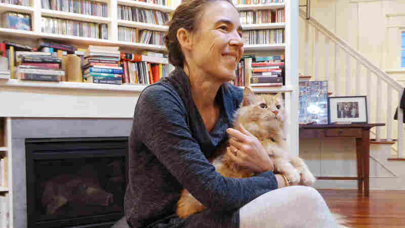 "Back in Seattle after six weeks of Ebola duty in West Africa, Karin Huster was told by the health department that she might want to send away her two cats during her quarantine — ""just in case."" The cats didn't go anywhere."