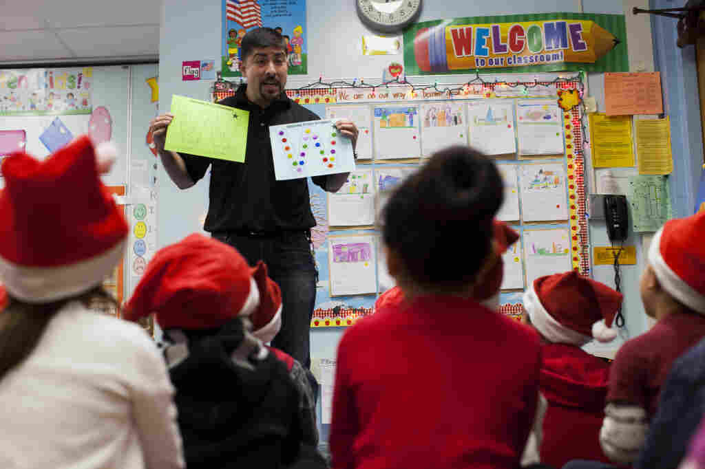 Hugo Villavicencio talks to kindergarten students at Lenicia B. Weemes Elementary School about the importance of attending school.
