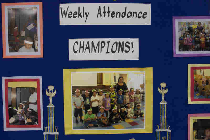 A poster in the hallway of Weemes Elementary recognizes students with positive attendance rates.
