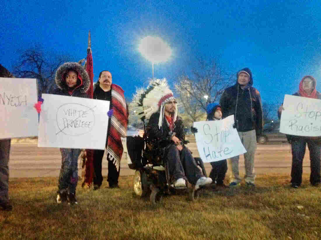 A small protest in Rapid City, S.D., including members of the Native American community, gather in front of the Civic Center where the incident occurred.
