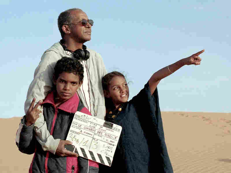 Sissako works on set with Timbuktu actors Mehdi A.G. Mohamed (left) and Layla Walet Mohamed.