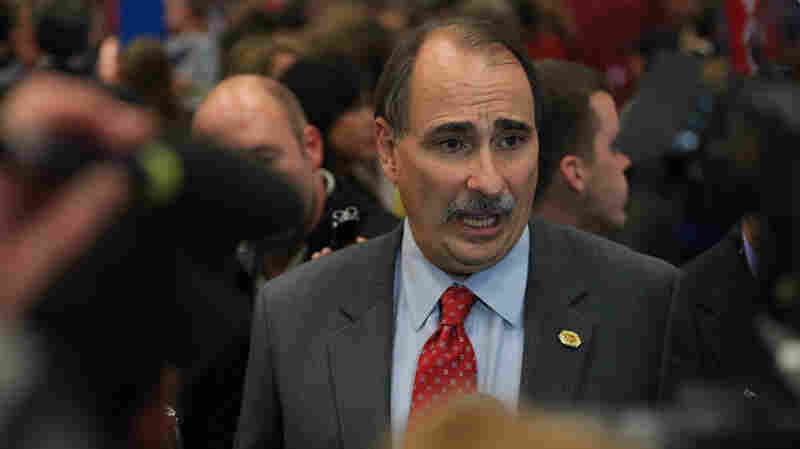 David Axelrod speaks to reporters after a presidential debate in October of 2012.