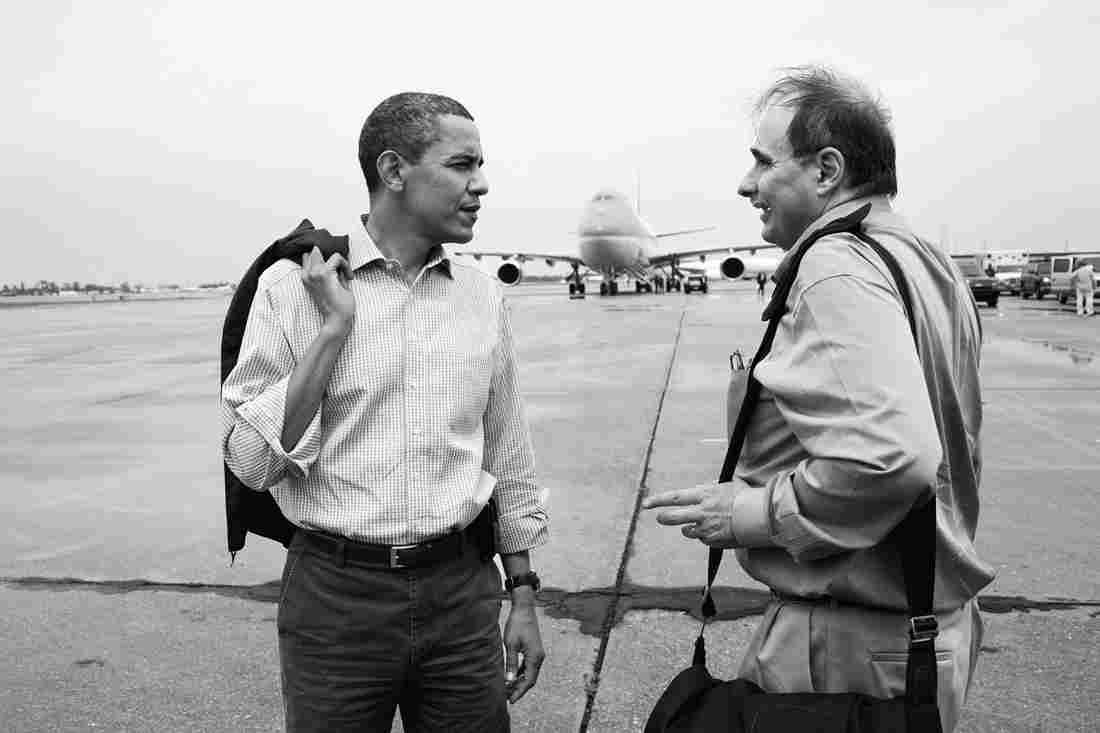 President Obama talks with senior adviser David Axelrod at the airport in New Orleans following a meeting on the response to the BP oil spill in the Gulf of Mexico in 2010.