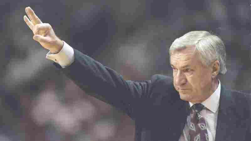 UNC Tar Heels head basketball coach Dean Smith gives instructions during a 1997 playoff game against the Colorado Buffaloes. Smith died Saturday. He was 83.