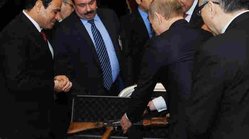 Russian President Vladimir Putin presents Egyptian President Abdel-Fattah el-Sissi an AK-47 assault rifle upon his arrival at the Cairo International Airport in Egypt on Monday.