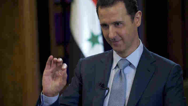Syria's President Bashar Assad is seen Monday during the filming of an interview with the BBC in Damascus. Assad said third parties including Iraq were conveying information about a U.S.-led campaign of airstrikes against the self-declared Islamic State group in Syria.