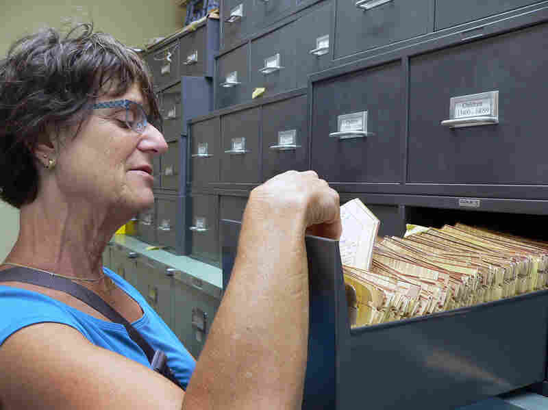 Barbara Cohn, director of the Child Health and Development Studies, looks through participant files collected over 56 years.