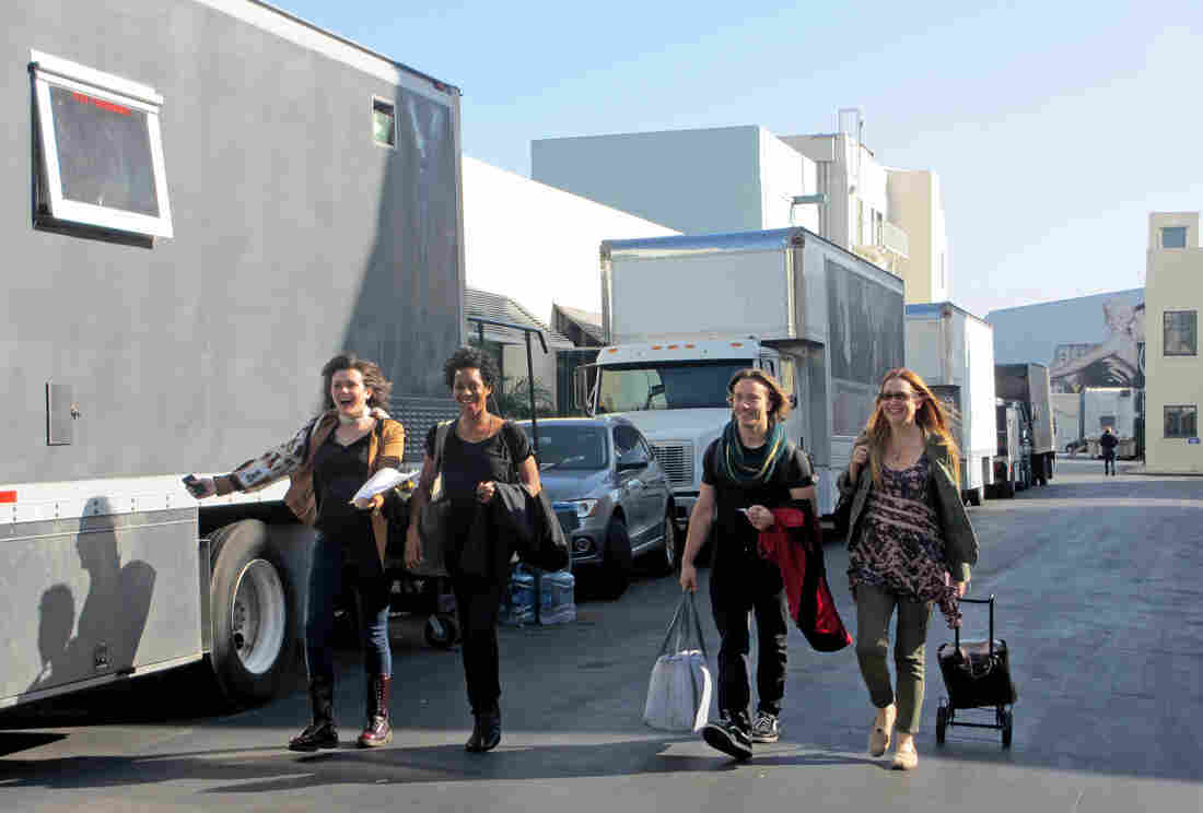 Loopers (from left) Nathalie Ciulla, Lanei Chapman, Aaron Fors and Catherine Cavadini walk through the studio lot after a looping session.