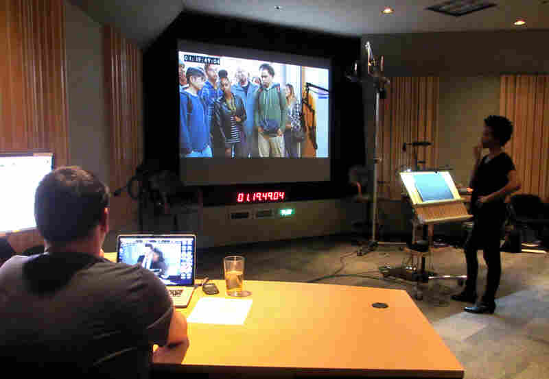 Supervising sound editor Rob Nokes (left) and looper Lanei Chapman watch a silent scene to get a sense of what to say during a looping session for the television show Bones.