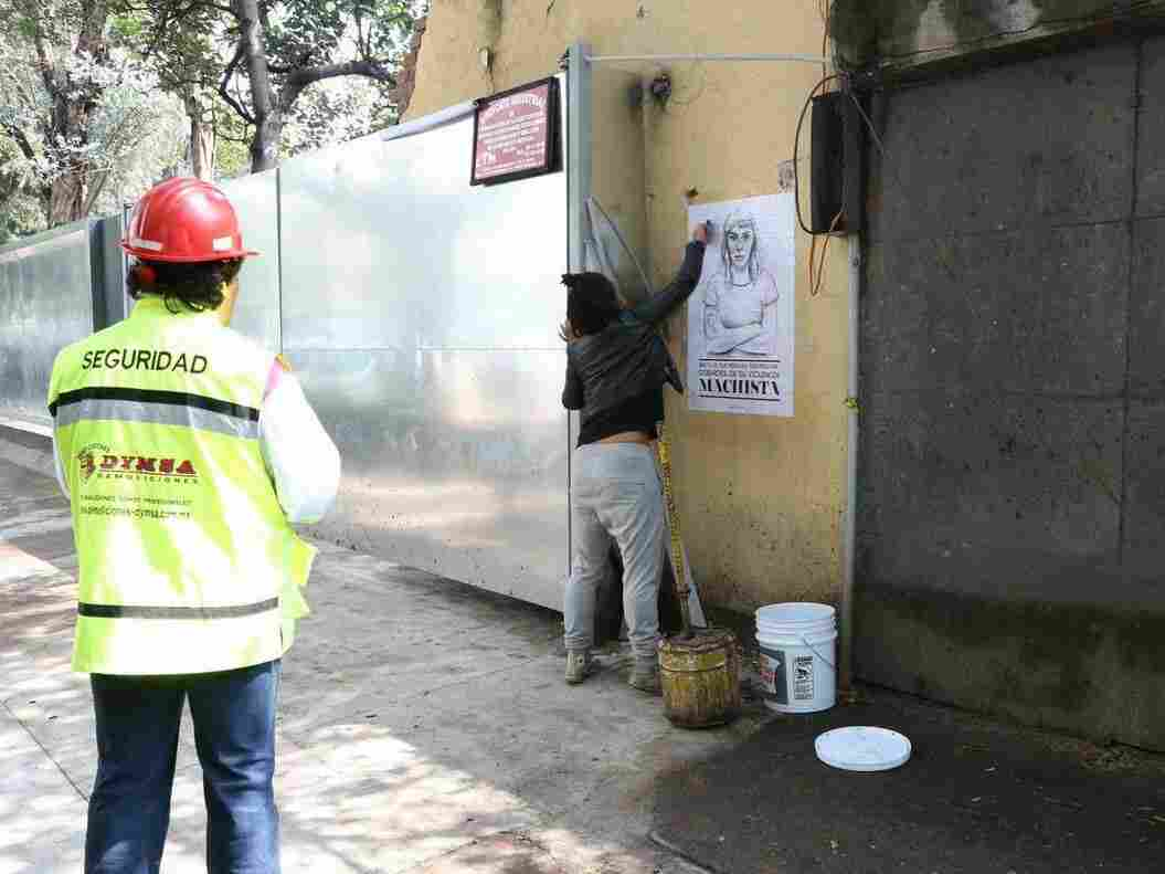 Tatyana Fazlalizadeh, a Brooklyn-based artist, pasting a poster in Mexico City.