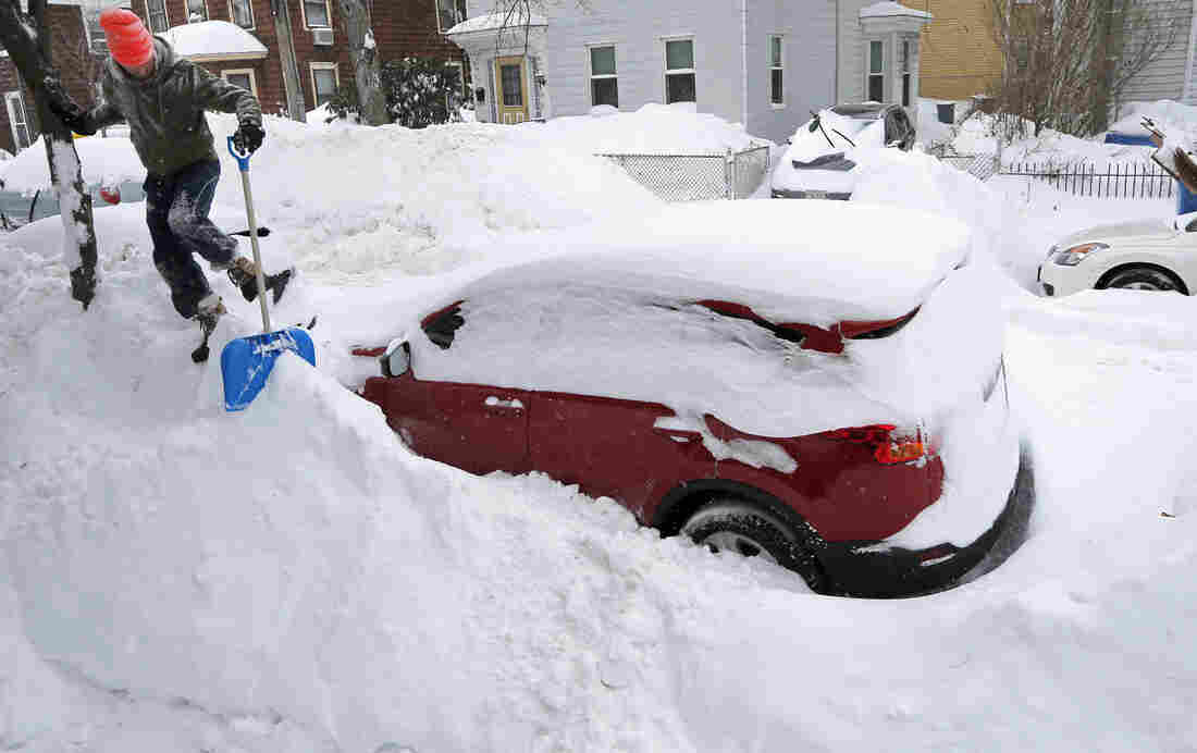 Greg Burkett clears snow from a winter storm in Cambridge, Mass., on Monday. Boston has had more than 6 feet of snow in the past 30 days.