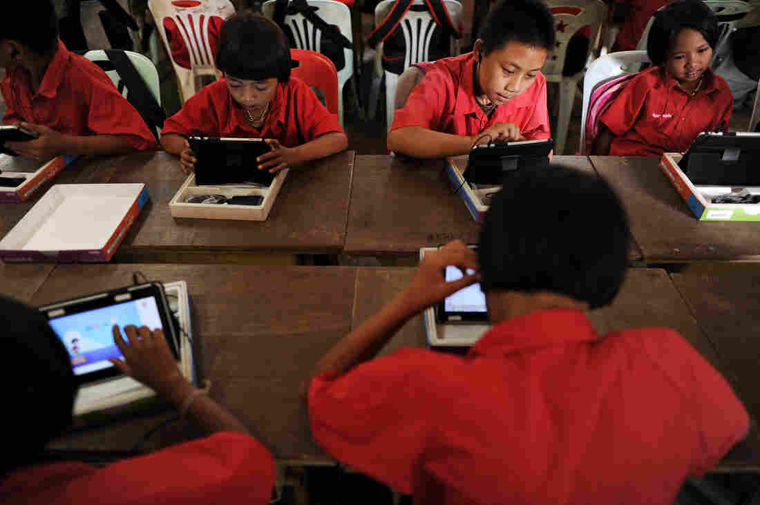 Students use tablets in a classroom in Mae Chan, a remote town in Thailand's northern province.