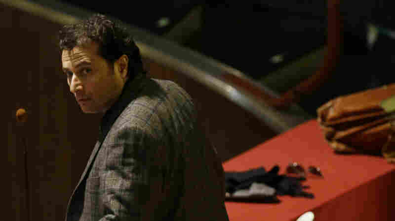 Francesco Schettino attends his trial in Grosseto, Italy, on Wednesday. The captain of the capsized Costa Concordia luxury liner has been convicted of multiple charges of manslaughter and sentenced to 16 years in jail.