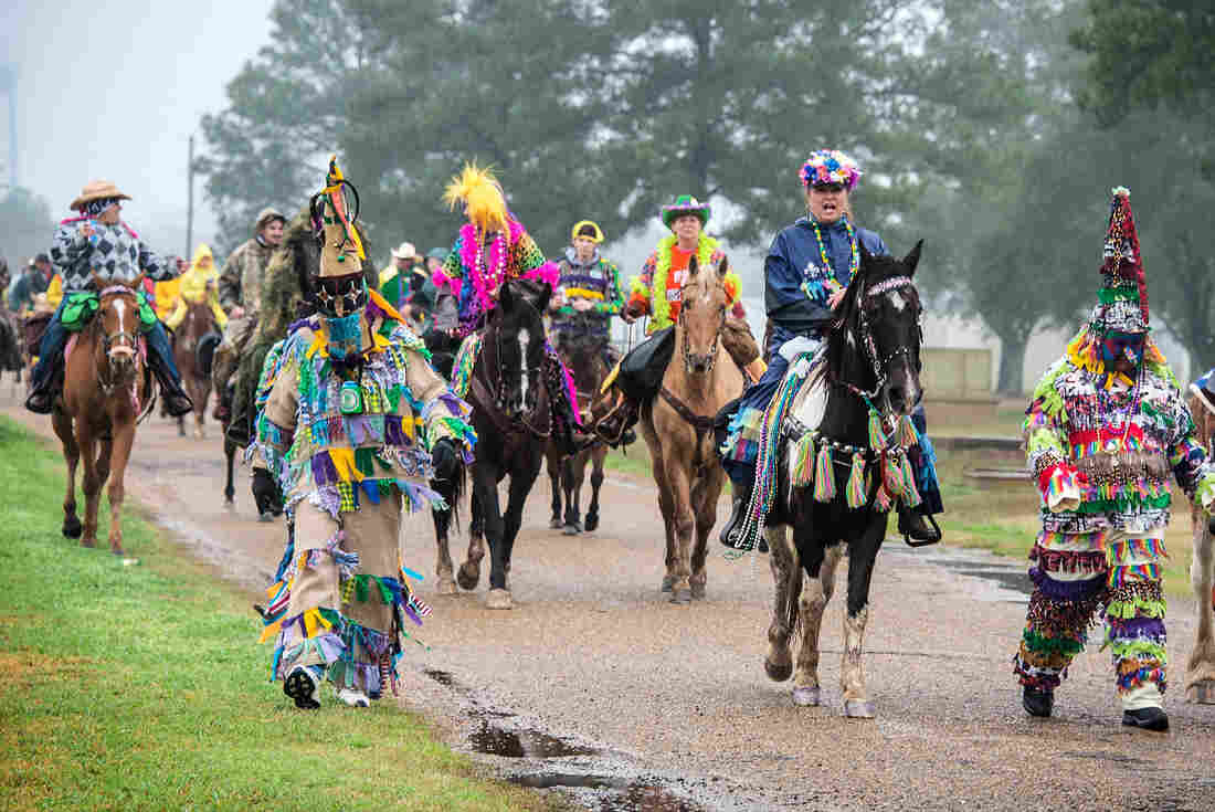 Costumed participants in the Courir de Mardi Gras in Eunice, La., in February 2013. The courir is a procession on foot, horseback and by trailer, rooted in a rural custom of gathering ingredients for a communal meal from area farms.
