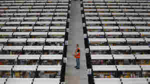 A an employee works at Amazon's fulfillment center in Rugeley, central England, in 2012. President Obama wants Amazon and other U.S. companies to bring more of their overseas earnings home.