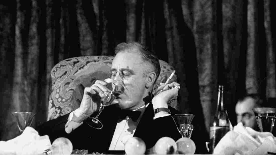 President Franklin Delano Roosevelt drinks a glass of wine at a fundraising dinner in 1938. FDR fancied himself quite the skilled mixologist; many of his colleagues disagreed.