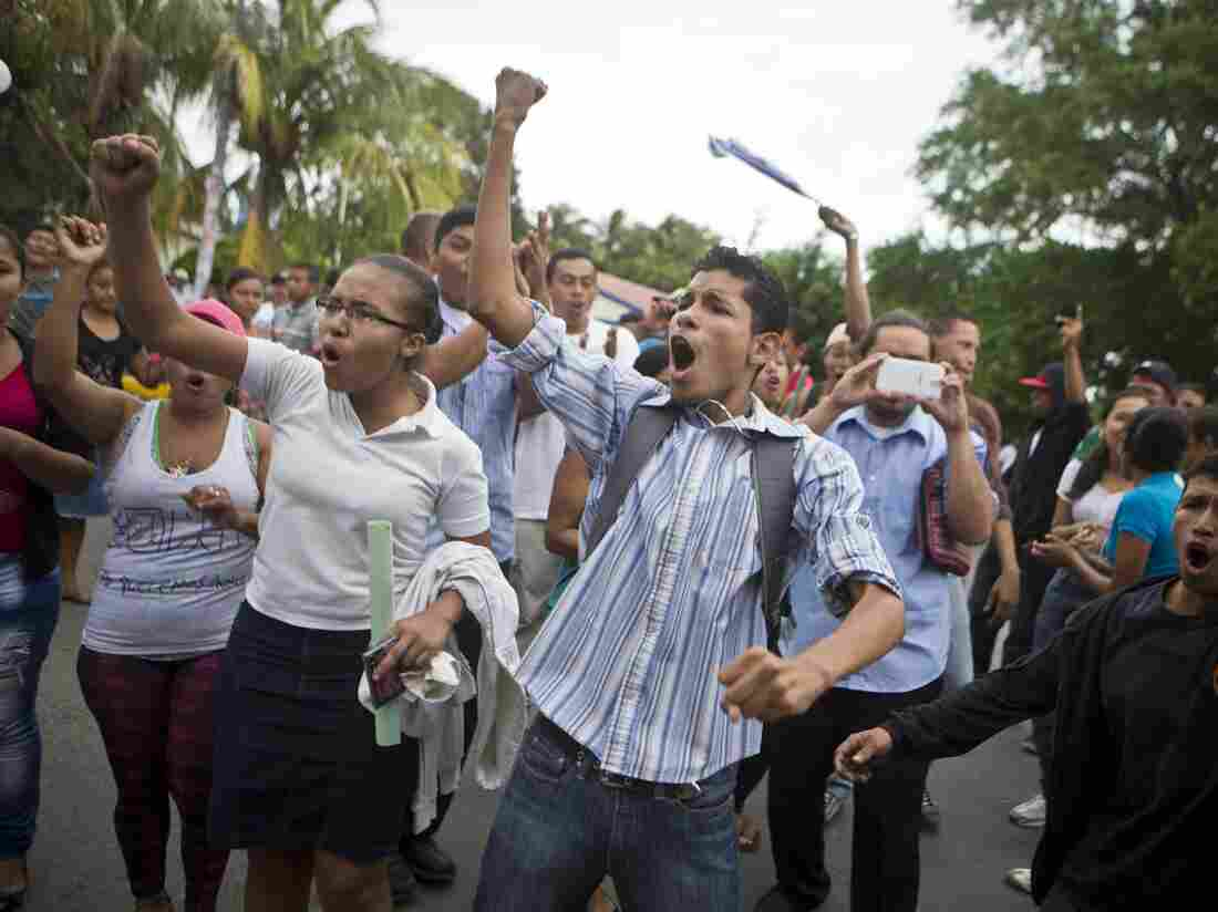 Residents shout slogans during a protest march against the construction of the planned interoceanic canal, in San Jorge, Nicaragua, in October.