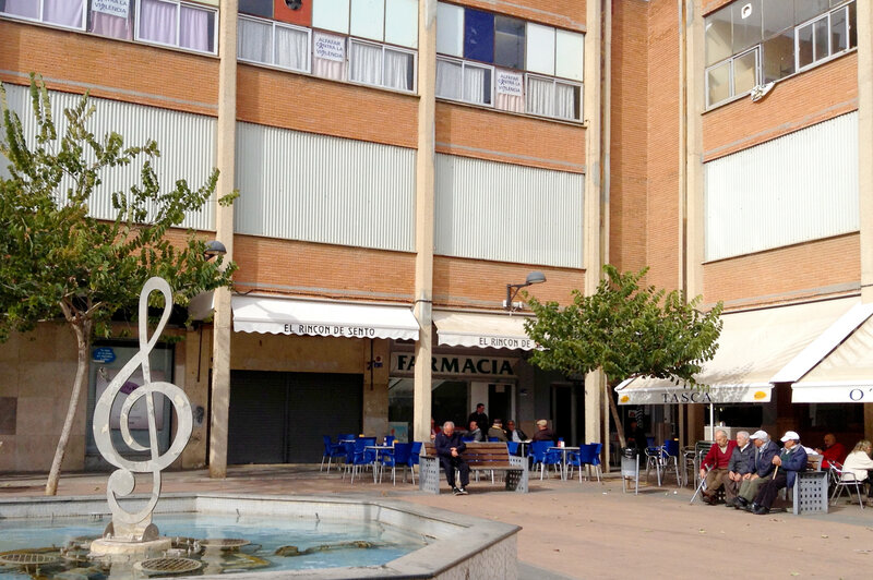Alfafar, a suburb of Valencia, Spain, is suffering from a poor economy and high unemployment. A quarter of homes are abandoned. Here, a cafe is still open on the ground floor of an abandoned municipal building in Alfafar's Orba neighborhood, but upper floors used to house shops. A pair of Spanish architects hopes to revitalize the high-density housing in this working-class area.