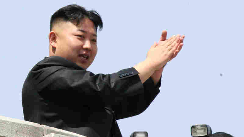 North Korean leader Kim Jong Un claps as he reviews a mass military parade from a balcony in Kim Il Sung Square in Pyongyang, North Korea, in 2012.