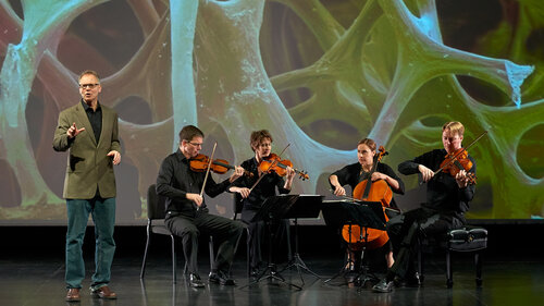 "Robert Davies (standing) and the quartet during a performance of ""The Crossroads Project."" Musicians include (left to right) Robert Waters, Rebecca McFaul, Anne Francis Bayliss and Bradley Ottesen."